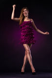 Beautiful woman in purple dress dancing Royalty Free Stock Photo