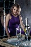 Beautiful woman in purple dress - night restaurant Royalty Free Stock Photo