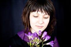 Beautiful woman with purple flowers Stock Photo