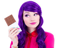Beautiful woman with purple hair holding chocolate and thinking Stock Photos