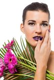 Beautiful woman in purple make-up Stock Image