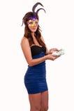 Beautiful woman in purple mysterious venetian mask posing Stock Photography