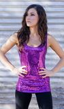 Beautiful  woman in purple sequined top Royalty Free Stock Images