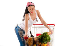 Beautiful woman pushes a trolley Stock Photography