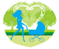 Beautiful  woman pushing a stroller Royalty Free Stock Photo