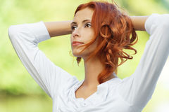 Beautiful woman put her head Stock Images