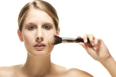 Beautiful woman put on makeup Stock Image