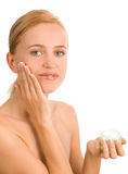 Beautiful woman puts a cream 2 Royalty Free Stock Photography