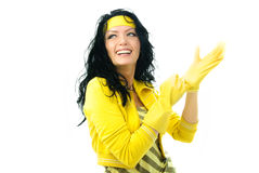 Beautiful woman puts on rubber gloves Stock Photo