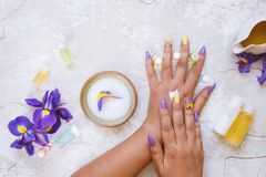 Beautiful woman putting cosmetic cream on her hand Royalty Free Stock Photography