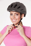 Beautiful woman putting on a helmet Royalty Free Stock Images