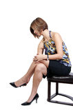 Beautiful Woman Putting on Her Shoes Royalty Free Stock Photos