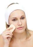 Beautiful woman putting make-up Stock Photo