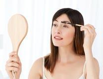 Beautiful woman putting on Make up Royalty Free Stock Photos