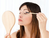 Beautiful woman putting on Make up Royalty Free Stock Images