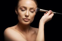 Beautiful woman putting make up on Royalty Free Stock Photo