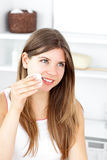 Beautiful woman putting make-up on her face Stock Photo
