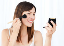 Beautiful woman putting on Make up up Royalty Free Stock Photo
