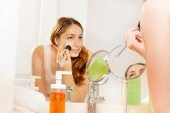 Free Beautiful Woman Putting Make Up With Powder Brush Stock Photography - 105195012