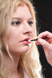 Beautiful woman putting on makeup Royalty Free Stock Photo