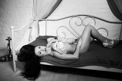 Beautiful woman with python. Black & white, monochrome vintage photo, one person is holding wild albino python. Erotic emotional atmosphere, passion, desire Royalty Free Stock Photo