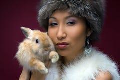 Beautiful woman with rabbit Stock Photography