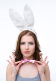 Beautiful woman in rabbit ears holding her butterfly Stock Image