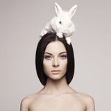 Beautiful woman with rabbit Royalty Free Stock Photos