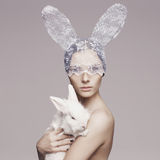 Beautiful woman with rabbit Stock Photography