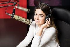 Beautiful woman radio broadcaster Stock Images