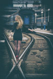 Beautiful woman on the rails Royalty Free Stock Image