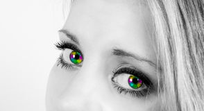Beautiful woman with rainbow colored eyes. Beautiful woman in semi profile with beautiful rainbow colored eyes looking straight into the camera Stock Photos