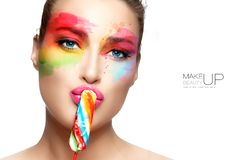 Beautiful woman with rainbow colored makeup. Fashion makeup and cosmetics concept. Fine art beauty portrait royalty free stock photography