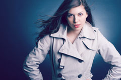 beautiful woman in the raincoat Stock Image