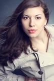 Beautiful woman in the raincoat Royalty Free Stock Photo
