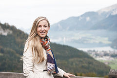 Beautiful woman in a raincoat and scarf Royalty Free Stock Images