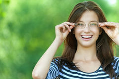 Beautiful woman raised glasses Royalty Free Stock Image