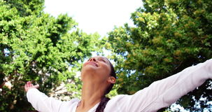 Beautiful woman raising arms and enjoying outdoors stock video footage
