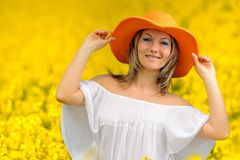Beautiful woman on rape field Royalty Free Stock Photos