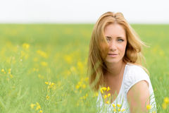 Beautiful woman in rape field Royalty Free Stock Photography