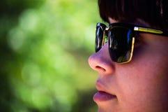 Beautiful woman in rays of sun Royalty Free Stock Image