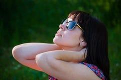 Beautiful woman in rays of sun Stock Photography