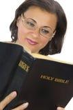 Beautiful woman reading bible Stock Photography