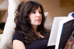 Beautiful woman reading a book stock images