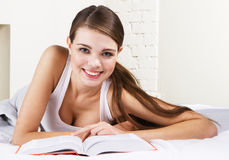 Beautiful woman reading a book stock image