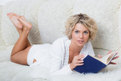 Beautiful woman reading book at bedroom Royalty Free Stock Image