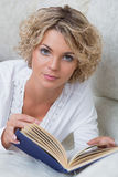 Beautiful woman reading book at bedroom Royalty Free Stock Photography