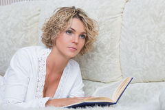 Beautiful woman reading book at bedroom Royalty Free Stock Photos