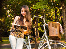 Beautiful woman reading a book Stock Photo