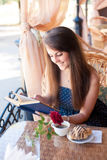 Beautiful woman reading a book in the cafe Royalty Free Stock Photography